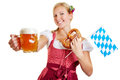 Woman holding beer pretzel and bavarian flag happy in a dirndl a Stock Photos