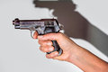 Woman holding beretta gun in her hand and aiming Royalty Free Stock Photo