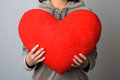 Woman holding a big heart studio shot of with red Royalty Free Stock Photos