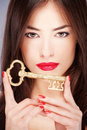 Woman holding big old key Royalty Free Stock Photos