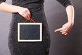 Woman holding blank black board on crotch Royalty Free Stock Photo