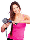 Woman holding blow dryer and comb with long hair Royalty Free Stock Photo