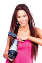 Woman holding blow dryer and comb with long hair Royalty Free Stock Photos