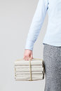 Woman holding books as a parcel young stack of wrapped tied with rope Royalty Free Stock Photo