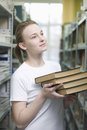 Woman holding books in library beautiful young women Stock Photography