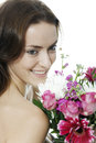 Woman holding a bouquet of flowers attractive young colourful smiling Stock Photos
