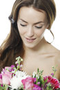 Woman holding a bouquet of flowers attractive young colourful smiling Stock Image