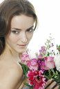 Woman holding a bouquet of flowers attractive young colourful smiling Stock Images