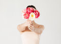 Woman holding bouquet of flowers over her face Stock Photos