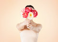 Woman holding bouquet of flowers over her face Royalty Free Stock Photos