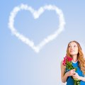 Woman holding bouquet of roses and dreaming Stock Image