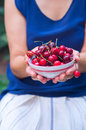 Woman holding bowl of cherries fresh in hands Royalty Free Stock Photography