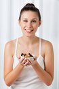 Woman holding bowl of dry fruits portrait an attractive young Stock Image
