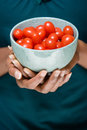 Woman holding bowl of tomatoes Royalty Free Stock Photo