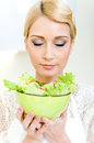 Woman holding a bowl with vegetable salad Royalty Free Stock Photography