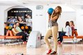 Woman holding bowling ball in club portrait of beautiful young women with people background Stock Images