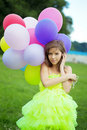Woman holding bunch of colorful air balloons Stock Photos