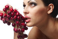 Woman holding a bunch of red cherries Stock Photography