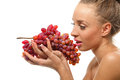 Woman holding a bunch of red grapes Royalty Free Stock Photography