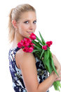 Woman holding a bunch of red tulips bouquet Royalty Free Stock Photos