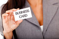 Woman holding a business card Royalty Free Stock Images