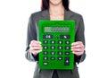 Woman holding calculator. Focus on calculator Royalty Free Stock Photo