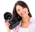 Woman holding a camera professional digital isolated over white Stock Photos