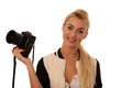 Woman holding a camera taking photos isolated over white backgro background Stock Photo