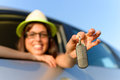 Woman holding car keys girl showing new after buying it travel and rental concept Royalty Free Stock Photo