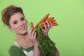Woman holding carrots Stock Photos
