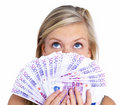 Woman holding cash on face and looking up Stock Photo