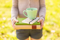 Woman holding chamomile tea and stacked books Royalty Free Stock Photo