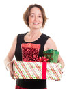 Woman holding christmas gifts a in a party dress an arm load of Royalty Free Stock Image