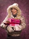 Woman holding a christmas present Royalty Free Stock Images