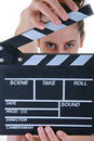 Woman holding clapper board Royalty Free Stock Images