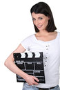 Woman holding a clapperboard Stock Photography