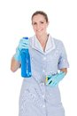 Woman holding cleaning liquid and scrubber over white background Stock Images