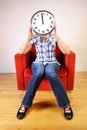 Woman holding a clock Royalty Free Stock Images