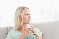 Attractive woman having morning tea at home