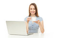 Woman holding coffee cup while using laptop Stock Photos
