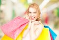 Woman holding color shopping bags in mall Royalty Free Stock Image