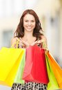 Woman holding color shopping bags in mall presents and gifts attractive Stock Image