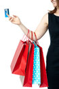 Woman holding colorful shopping bags and cash card Royalty Free Stock Images