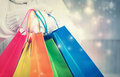 Woman holding colorful shopping bags Royalty Free Stock Photo