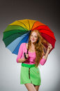 Woman holding colourful umbrella Royalty Free Stock Photo