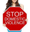 Woman holding conceptual stop sign domestic abuse violence Royalty Free Stock Photography