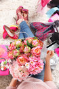 Woman holding a credit card close up of beautiful spring flower bucket and Royalty Free Stock Image