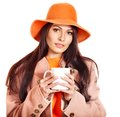 Woman holding  cup of coffee. Stock Photography