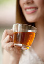 Woman holding a cup of tea asian hot to drink Stock Photo