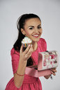 Woman holding cupcake smiling cup cake isolated in studio Royalty Free Stock Photos